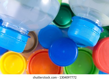 Two bottles of water and colorful covers. Closeup image