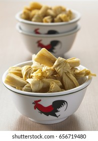 two bowls of dried bean curd skin tie in knots