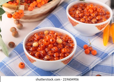 Two bowls of jam with rowan and hazel nuts