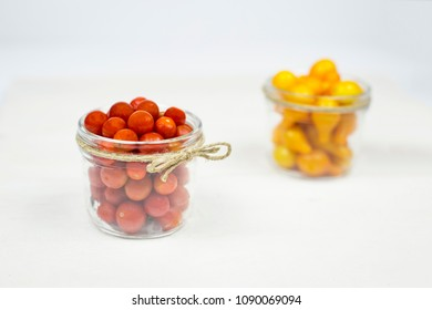 Two bowls of red and yellow cherry tomato