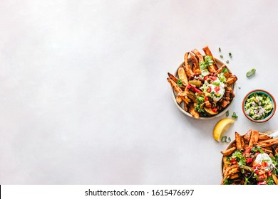 Two bowls of sweet potato fries wedges or chips flat lay background or backdrop with copy space
