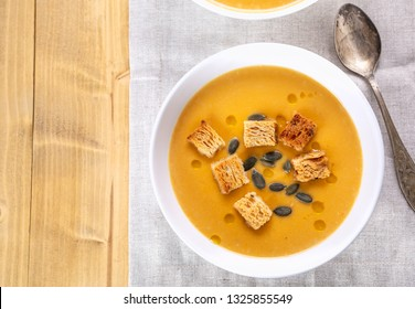Two  Bowls of Traditional Pumpkin Soup served with croutons and pumpkin seeds