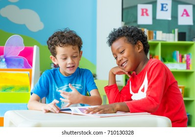Two boy kid sit on table and reading tale book  in preschool library,Kindergarten school education concept,children day card
