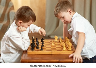 Two boy playing chess