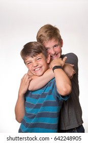 Two boys (brothers) hugging/choking each other