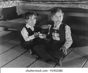 Two boys with Cake