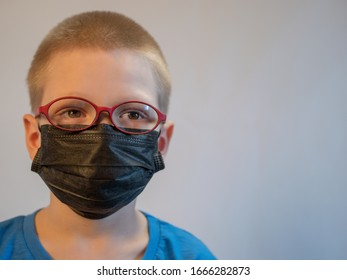 Two boys in dirty medical masks are quarantined at home. Children cough hard and get dirty with masks quickly. concept of fight against coronavirus epidemic and proper prevention of infections