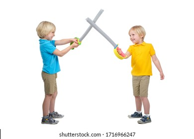 Two boys fencing isolated in studio on white background