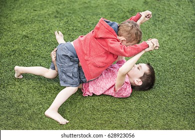 two boys fighting. children on the sports field