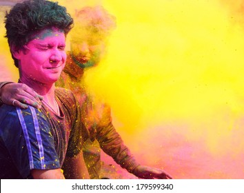 Two boys in the fog of colors/ gulal during Holi celebration in India.
