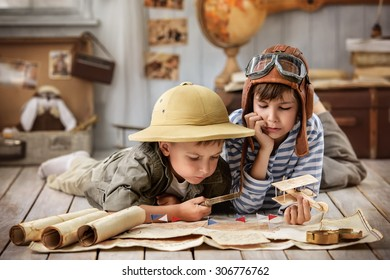 Two boys in the form of pilot and traveler read the old card in my room