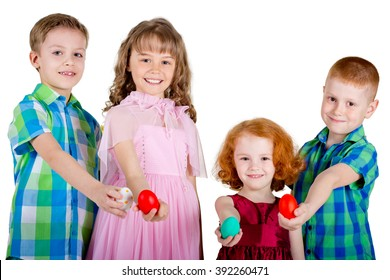 Two boys and two girls hold Easter eggs in straight arms. Children are showing Easter eggs. White background.