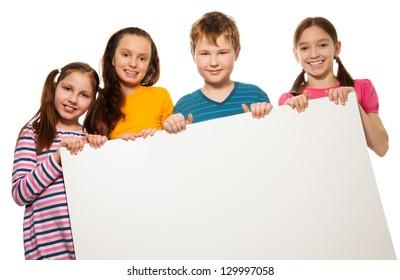 Two boys and two girls showing blank white placard board to write it on your own text isolated on white background