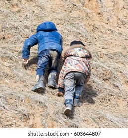 Two boys are going uphill