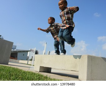 Two Boys Jumping from a Bench