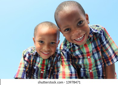 Two Boys Looking Down and Smiling