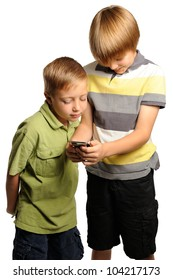 Two boys Looking at a portable internet device. Seven and nine year old boys looking at a portable internet device.