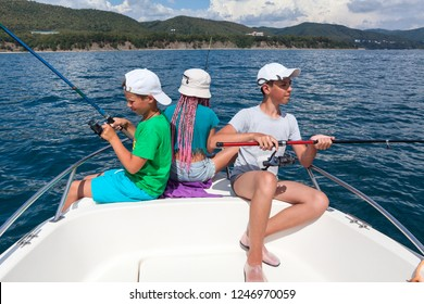 Two boys and one girl have fishing on a sailboat, deep-sea fishing trip
