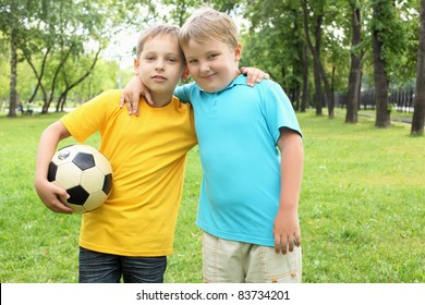 two boys in the park with a ball