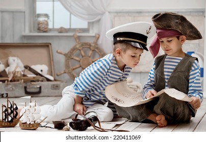 Two boys, a pirate captain, read travel map in her room