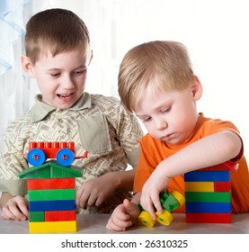 Two boys play on a white background