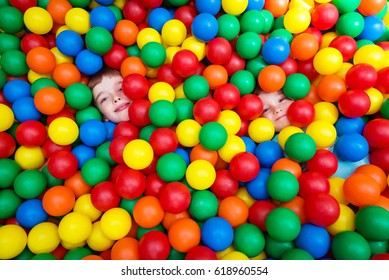 Two boys playing in colored balls