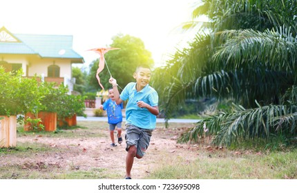 Two boys Playing kite have fun.