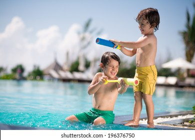 Two boys playing in the swimming pool