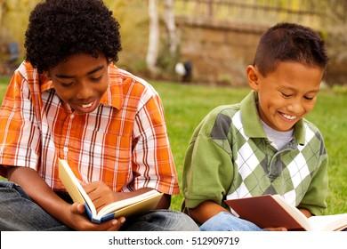 Two boys reading.