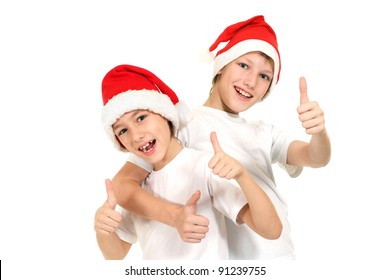 two boys in santa hats on a white