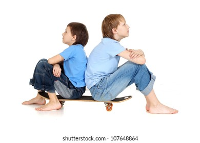 Two boys sitting on a skateboard are thinking on a white background