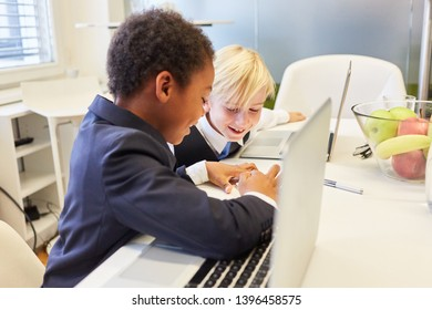 Two boys as students or business people learn together in computer class