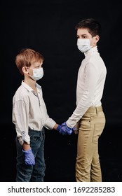 two boys use medical masks for communication during virus time