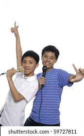 Two boys,with microphone isolated on white