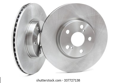 two brake discs on a white background