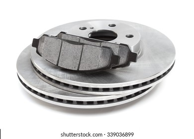two brake discs and brake pads on a white background. car parts