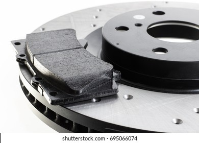 two brake discs and pads on a white background