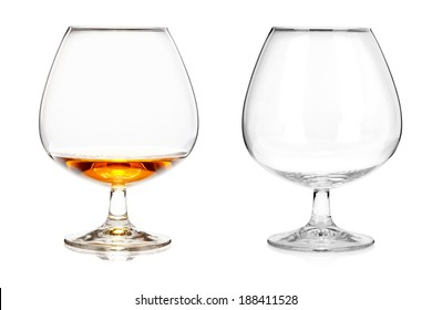 Two brandy glasses (empty and with alcohol) isolated on white background