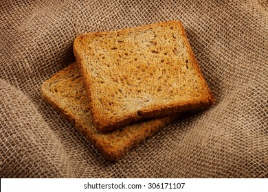 Two bread hot toasts on the sack background