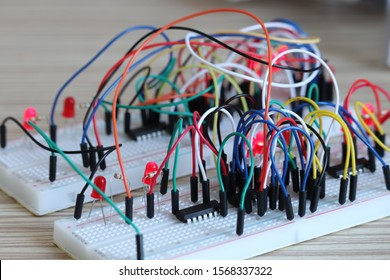 Two breadboard with cables and leds. Logic circuits