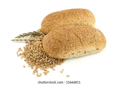 two breads and wheat isolated on white