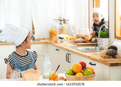 Two brethren happy with preparing the breakfast in the kitchen