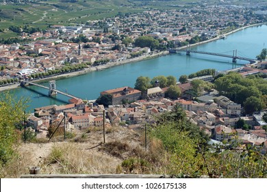 Two bridges over the river Rhone in Tournon-sur-Rhone in France