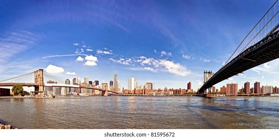 Two bridges - panoramic shot of Brooklin and Manhattan bridges taken from quay