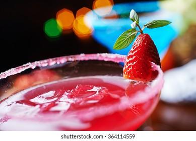two bright refreshing cocktails: blue margarita and strawberry daiquiri.