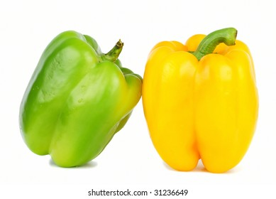 Two of brightly colored capsicums paprika  isolated on white.