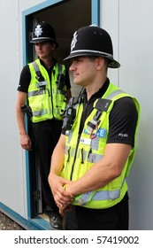 Two British Police Constables in uniform standing together