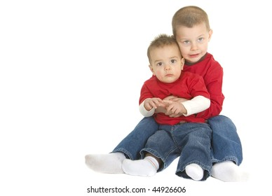 two brother sitting on floor hugging each other