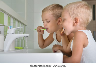 Two brothers brush my teeth in the bathroom.The beginning of a new day
