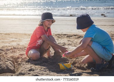 Two Brothers Building Sand Castles at the Beach in Northland New Zealand